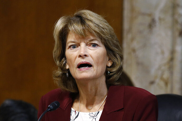 """FILE - In this Dec. 19, 2019 file photo, Sen. Lisa Murkowski, R-Alaska, chair of the Senate Energy and Natural Resources Committee, speaks during a hearing on the impact of wildfires on electric grid reliability on Capitol Hill in Washington.  Murkowski says she was """"disturbed"""" to hear Senate Majority Leader Mitch McConnell say there would be """"total coordination"""" between the White House and the Senate over the presidential impeachment trial. In an interview with KTUU, Murkowski said she remains undecided on how she would vote when the trial takes place. She was critical of the impeachment process in the House, describing it as rushed. But she said there should be distance between the Trump administration and the Senate on how the trial is conducted.(AP Photo/Patrick Semansky, File)"""