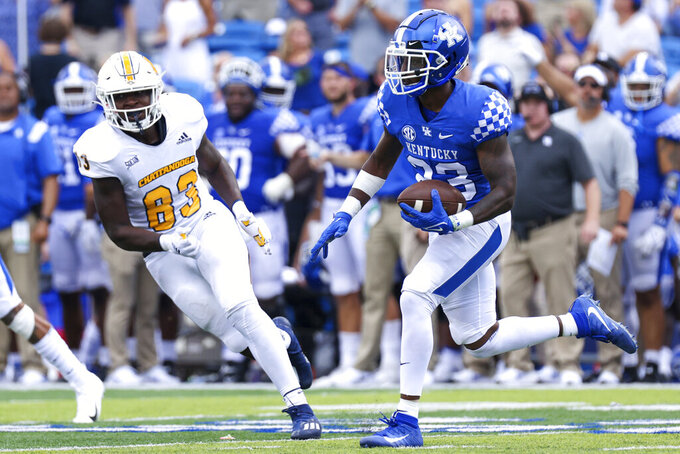 Kentucky defensive back Tyrell Ajian (23) returns an interception 95-yards for a touchdown late in the fourth quarter of an NCAA college football game against Chattanooga in Lexington, Ky., Saturday, Sept. 18, 2021. (AP Photo/Michael Clubb)