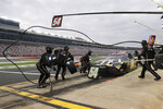 Kyle Busch makes a pit stop during a NASCAR Xfinity Series auto race at Charlotte Motor Speedway Monday, May 25, 2020, in Concord, N.C. (AP Photo/Gerry Broome)