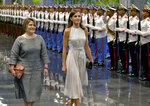 Spain's Queen Letizia, center, walks with Lis Cuesta Peraza, wife of Cuban President Miguel Diaz-Canel, after a review of an honor guard at Revolution Palace in Havana, Cuba, Tuesday, Nov. 12, 2019.  (Yamil Lage/Pool photo via AP)