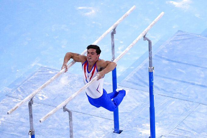 Artur Dalaloyan, of the Russian Olympic Committee, performs on the parallel bars during men's artistic gymnastics team final at the 2020 Summer Olympics, Monday, July 26, 2021, in Tokyo, Japan. (AP Photo/Jeff Roberson)