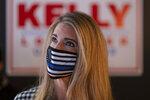 U.S. Sen. Kelly Loeffler, R-Ga., talks to supporters during a campaign event Friday, Dec. 31, 2020 at McCray's Tavern in Marietta, Ga. (AP Photo/Ben Gray)