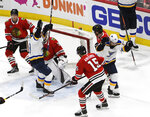St. Louis Blues center Tyler Bozak, right, celebrates his goal against the Chicago Blackhawks during the third period in an NHL hockey game Wednesday, April 3, 2019, in Chicago. The Blackhawks won 4-3 in a shootout. (AP Photo/David Banks)