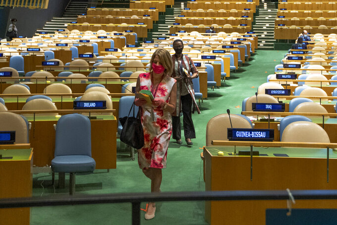 Norway's ambassador to the United Nations, Mona Juul, prepares to cast a vote during U.N. elections, Wednesday, June 17, 2020, at U.N. headquarters in New York. Norway and Ireland won contested seats on the powerful U.N. Security Council Wednesday in a series of U.N. elections held under dramatically different voting procedures because of the COVID-19 pandemic. (Eskinder Debebe/UN Photo via AP)