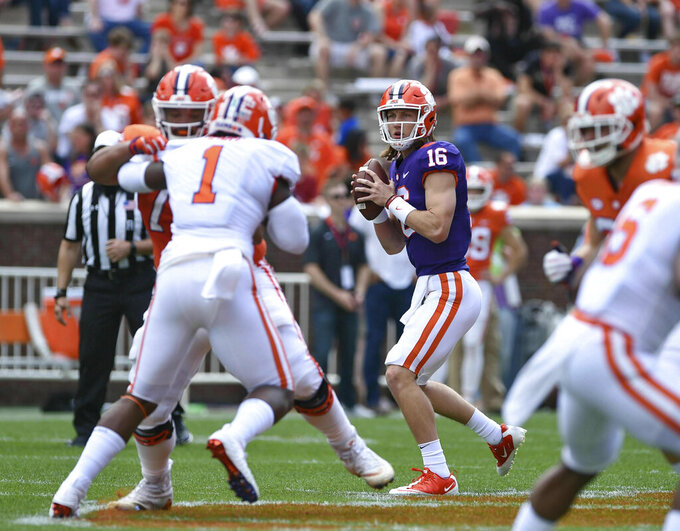 Clemson's Trevor Lawrence (16) drops back to pass during Clemson's annual Orange and White NCAA college football spring scrimmage Saturday, April 6, 2019, in Clemson, S.C. (AP Photo/Richard Shiro)