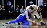 Air Force's Christopher Joyce and Fresno State's New Williams, right, reach for a loose ball during the second half of an NCAA college basketball game in the Mountain West Conference men's tournament Thursday, March 14, 2019, in Las Vegas. (AP Photo/Isaac Brekken)