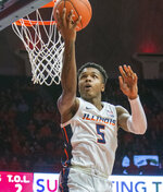 Illinois guard Tevian Jones (5) tips in a pass backward during the second half of an NCAA college basketball game against Nebraska in Champaign, Ill., Saturday, Feb. 2, 2019. (AP Photo/Robin Scholz)