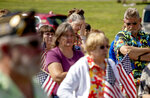 Members of the public attend a memorial service Saturday, Aug. 31, 2019, in Trumansburg, N.Y., for Sgt. James Johnston, who was killed in Afghanistan in June. Hundreds of people, some wearing Hawaiian shirts and plastic leis in Johnston's honor, lined a pathway next to bricks etched with the names of local boys who'd gone to war, some never to return. The gathering was a combination barbecue, fundraiser and day of remembrance. (AP Photo/David Goldman)