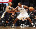 "FILE - In this Dec. 18, 2012, file photo, Brooklyn Nets shooting guard Joe Johnson (7) drives the ball around Utah Jazz point guard Randy Foye (8) in an NBA basketball game at Barclays Center in New York. The Nets' 2012 acquisition of Johnson to play with point guard Deron Williams was a pairing that was touted as ""Brooklyn's Backcourt."" (AP Photo/Kathy Kmonicek, File)"