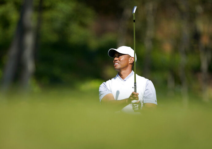 Tiger Woods watches his second shot on the fifth hole during the second round of the Genesis Invitational golf tournament at Riviera Country Club, Friday, Feb. 14, 2020, in the Pacific Palisades area of Los Angeles. (AP Photo/Ryan Kang)