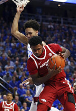 Arkansas' Adrio Bailey, bottom, pulls down a rebound near Kentucky's EJ Montgomery during the first half of an NCAA college basketball game in Lexington, Ky., Tuesday, Feb. 26, 2019. (AP Photo/James Crisp)