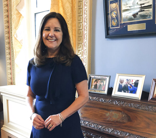 FILE- In this Jan. 31, 2020 file photo, Karen Pence, wife of Vice President Mike Pence, poses for a photograph in her office in the Eisenhower Executive Office Building, on the White House campus in Washington. Second Lady Pence visited Great Smoky Mountains National Park Tuesday, May 19, to talk about the mental health benefits of spending time outdoors as officials announced the second phase of a plan to reopen all park trails. (AP Photo/Darlene Superville, File)