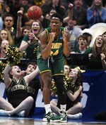 Vermont's Ben Shungu (24) reacts during the first half of a first round men's college basketball game against Florida State in the NCAA tournament, Thursday, March 21, 2019, in Hartford, Conn. (AP Photo/Jessica Hill)