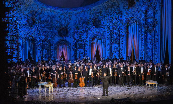 In this Dec. 4, 2018 photo released by the Metropolitan Opera, conductor Yannick Nézet-Séguin and the orchestra at a curtain call following the new production premiere of Verdi's