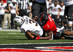 Texas Tech's Jordyn Brooks (1) tackles Oklahoma State's Spencer Sanders (3) to stop a two-point conversion during the second half of an NCAA college football game Saturday, Oct. 5, 2019, in Lubbock, Texas. (AP Photo/Brad Tollefson)