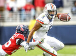Auburn's Anthony Schwartz (5) is tackled by Mississippi defensive back Jalen Julius (26) during an NCAA college football game at Vaught-Hemingway Stadium in Oxford, Miss., Saturday, Oct. 20, 2018. (Bruce Newman/The Oxford Eagle via AP)