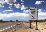 FILE - This Aug. 15, 2019, file photo shows the road to Spaceport America near Upham, New Mexico. An investigation into the conduct of Spaceport America's chief executive officer is ongoing and initial findings are expected in the coming weeks, the organization's interim leader said Wednesday, Sept. 2, 2020. (AP Photo/Susan Montoya Bryan, File)
