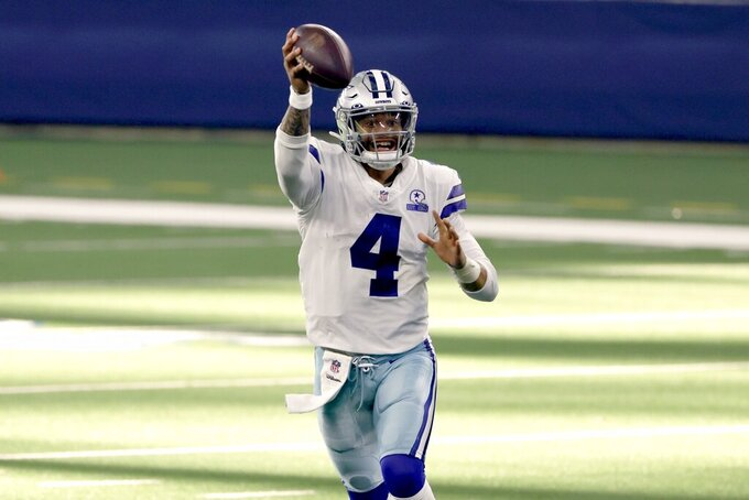 Dallas Cowboys quarterback Dak Prescott (4) pump fakes as he looks to throw a pass in the second half of an NFL football game against the New York Giants in Arlington, Texas, Sunday, Oct. 11, 2020. (AP Photo/Ron Jenkins)