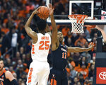 Virginia guard De'Andre Hunter, right, defends against a shot by Syracuse guard Tyus Battle during the first half of an NCAA college basketball game in Syracuse, N.Y., Monday, March 4, 2019. (AP Photo/Adrian Kraus)