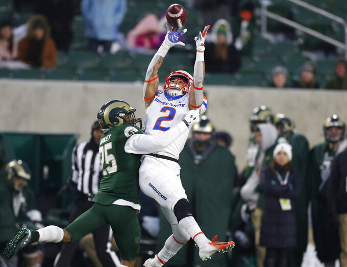 Boise State wide receiver Khalil Shakir, right, pulls in a pass over Colorado State cornerback Keevan Bailey in the second half of an NCAA college football game Friday, Nov. 29, 2019, in Fort Collins, Colo. Boise State won 31-24. (AP Photo/David Zalubowski)