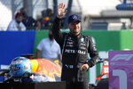 Mercedes driver Valtteri Bottas of Finland waves to fans after winning the Sprint Race qualifying session at the Monza racetrack, in Monza, Italy , Saturday, Sept.11, 2021. The Formula one race will be held on Sunday. (AP Photo/Luca Bruno)