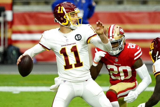 Washington Football Team quarterback Alex Smith (11) throws as San Francisco 49ers free safety Jimmie Ward (20) pursues during the first half of an NFL football game, Sunday, Dec. 13, 2020, in Glendale, Ariz. (AP Photo/Rick Scuteri)