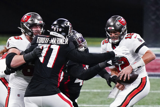 Atlanta Falcons linebacker Deion Jones (45) prepares to sack Tampa Bay Buccaneers quarterback Tom Brady (12) during the first half of an NFL football game, Sunday, Dec. 20, 2020, in Atlanta. (AP Photo/Brynn Anderson)