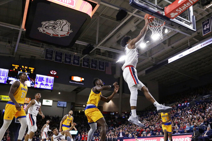 Gonzaga forward Rui Hachimura, right, dunks during the first half of the team's NCAA college basketball game against Cal State Bakersfield in Spokane, Wash., Monday, Dec. 31, 2018. (AP Photo/Young Kwak)