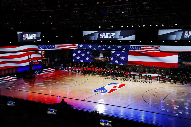 Players take a knee during the national anthem before Game 3 of an NBA basketball first-round playoff series between the Denver Nuggets and the Utah Jazz, Friday, Aug. 21, 2020, in Lake Buena Vista, Fla. (Mike Ehrmann/Pool Photo via AP)