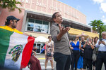 Cuban singer Eddie Marcos serenades the crowd outside of the Miami-Dade County Auditorium during a public funeral for the late Mexican singer Jose Jose, Sunday, October 6, 2019 in Miami. (AP Photo/Gaston De Cardenas)