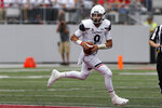 Cincinnati quarterback Desmond Ridder looks for an open pass against Ohio State during the first half of an NCAA college football game Saturday, Sept. 7, 2019, in Columbus, Ohio. (AP Photo/Jay LaPrete)