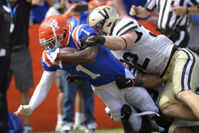 Florida wide receiver Jacob Copeland (1) scores a touchdown in front of Vanderbilt linebacker Ethan Barr (32) on a pass play in the second half of an NCAA college football game, Saturday, Oct. 9, 2021, in Gainesville, Fla. (AP Photo/Phelan M. Ebenhack)