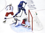 Columbus Blue Jackets goaltender Joonas Korpisalo (70) looks for the rebound as Toronto Maple Leafs right wing Kasperi Kapanen (24) and Blue Jackets defenseman Seth Jones (3) battle for the loose puck during the second period of an NHL hockey playoff game  Tuesday, Aug. 4, 2020 in Toronto. (Nathan Denette/The Canadian Press via AP)