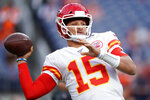 Kansas City Chiefs quarterback Patrick Mahomes (15) warms up prior to an NFL football game against the Denver Broncos, Thursday, Oct. 17, 2019, in Denver. (AP Photo/Jack Dempsey)