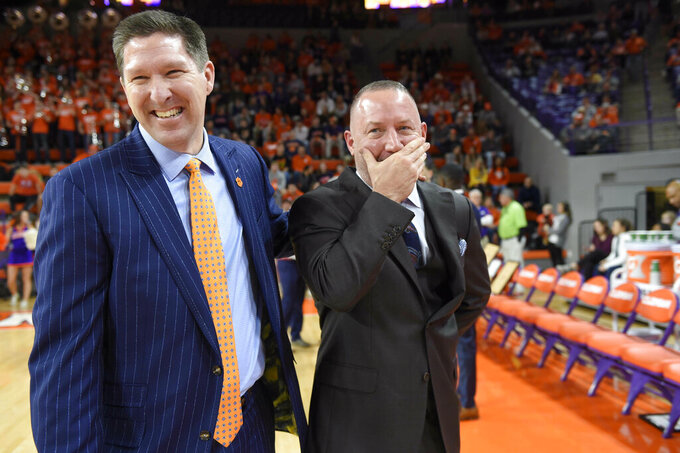 Clemson's head coach Brad Brownell, left, shares a laugh with Virginia Tech head coach Buzz Williams before the first half of an NCAA college basketball game Saturday, Feb. 9, 2019, in Clemson, S.C.. (AP Photo/Richard Shiro)