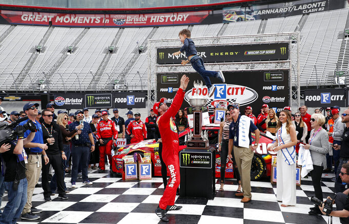 Driver Kyle Busch (18) celebrates with his son, Brexton Busch, after winning a NASCAR Cup Series auto race, Sunday, April 7, 2019, in Bristol, Tenn. (AP Photo/Wade Payne)