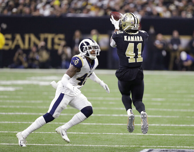 New Orleans Saints' Alvin Kamara catches a pass in front of Los Angeles Rams' John Johnson during the first half of the NFL football NFC championship game, Sunday, Jan. 20, 2019, in New Orleans. (AP Photo/David J. Phillip)