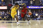 Austin Peay guard Antwuan Butler, right, runs the ball upcourt as he is defended by West Virginia guard Miles McBride, left, during the first half of an NCAA college basketball game Thursday, Dec. 12, 2019, in Morgantown, W.Va. (AP Photo/Kathleen Batten)