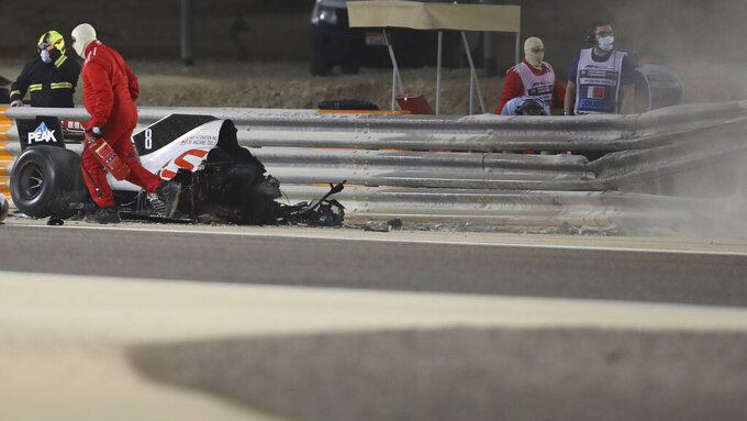 The parts of Haas driver Romain Grosjean's car is seen after he crashed during the Formula One race in Bahrain International Circuit in Sakhir, Bahrain, Saturday, Nov. 28, 2020. (Tolga Bozoglu, Pool via AP)