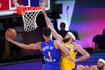 Denver Nuggets forward Michael Porter Jr. (1) attempts to take a shot as Los Angeles Lakers' JaVale McGee, right, defends during the second half an NBA conference final playoff basketball game, Friday, Sept. 18, 2020, in Lake Buena Vista, Fla. (AP Photo/Mark J. Terrill)