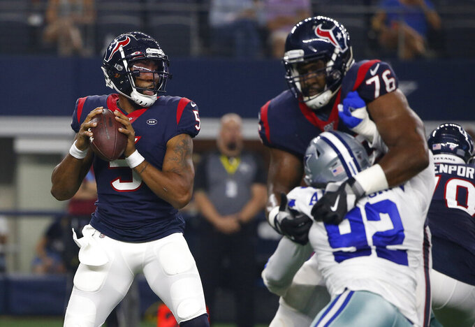 Houston Texans quarterback Joe Webb (5) prepares to throw a pass as offensive tackle Seantrel Henderson (76) helps against pressure from Dallas Cowboys' Dorance Armstrong (92) in the first half of a preseason NFL football game in Arlington, Texas, Saturday, Aug. 24, 2019. (AP Photo/Ron Jenkins)