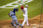 Washington Nationals Yan Gomes (10) and New York Mets catcher Tomás Nido (3) follow the ball as Gomes hit a foul ball during the third inning of a baseball game in Washington, Tuesday, Aug. 4, 2020. Nido missed the catch. (AP Photo/Manuel Balce Ceneta)