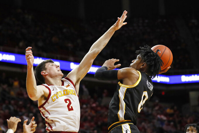 Southern Mississippi guard Gabe Watson shoots over Iowa State guard Caleb Grill (2) during the second half of an NCAA college basketball game, Tuesday, Nov. 19, 2019, in Ames, Iowa. Iowa State won 73-45. (AP Photo/Charlie Neibergall)