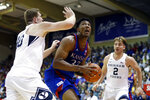 Kansas forward David McCormack (33) looks to shoot between BYU forward Kolby Lee (40) and guard Zac Seljaas (2) during the first half of an NCAA college basketball game, Tuesday, Nov. 26, 2019, in Lahaina, Hawaii. (AP Photo/Marco Garcia)
