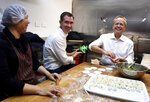 Australian Labour Party leader Bill Shorten, right, and local Labor candidate Sam Crosby, center, make dumplings during a visit to a Chinese restaurant in Sydney, Thursday, May 16, 2019. A federal election will be held in Australian on Saturday May 18, 2019. (Lukas Coch/AAP Image via AP)