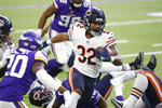 Chicago Bears running back David Montgomery (32) scores on a 14-yard touchdown run during the second half of an NFL football game against the Minnesota Vikings, Sunday, Dec. 20, 2020, in Minneapolis. (AP Photo/Bruce Kluckhohn)