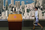 Hong Kong's Chief Executive Carrie Lam arrives at a press conference in Hong Kong Saturday, June 15, 2019. Lam said she will suspend a proposed extradition bill indefinitely in response to widespread public unhappiness over the measure, which would enable authorities to send some suspects to stand trial in mainland courts. (AP Photo/Kin Cheung)