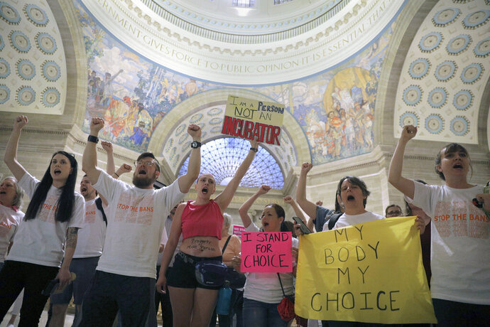 Abortion-rights activists react after lawmakers approved a sweeping piece of anti-abortion legislation, a bill that would ban most abortions in the state of Missouri, Friday, May 17, 2019 in Jefferson, Mo. If enacted, the ban would be among the most restrictive in the U.S. It includes exceptions for medical emergencies, but not for pregnancies caused by rape or incest. Doctors would face five to 15 years in prison for violating the eight-week cutoff. Women who receive abortions wouldn't be prosecuted. (Christian Gooden/St. Louis Post-Dispatch via AP)