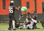Cleveland Browns linebacker Jadeveon Clowney, right, and cornerback M.J. Stewart run drills during practice at the NFL football team's training camp facility, Tuesday, Aug. 17, 2021, in Berea, Ohio. (AP Photo/Tony Dejak)