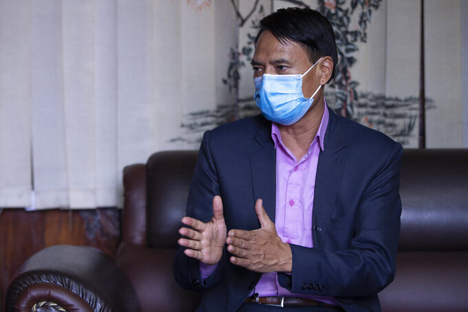 Nepalese Health Minister Sher Bahadur Tamang speaks during an interview with the Associated Press in Kathmandu, Nepal, Thursday, June 17, 2021. Nepal has been able to significantly lower reduce new coronavirus infections after its worst outbreak, but is in desperate need of vaccines, the health minister said Thursday. (AP Photos/Bikram Rai)